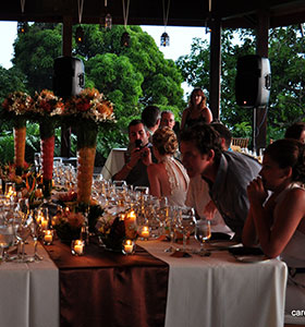 People sit at a dinner table in the pavilion