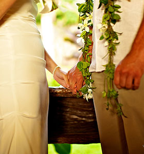 A couple holding hands during their wedding ceremony
