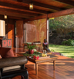 A sitting area look out beyond sliding glass doors into the garden