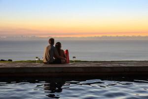 Couple enjoying sunset after their Big Island beach wedding