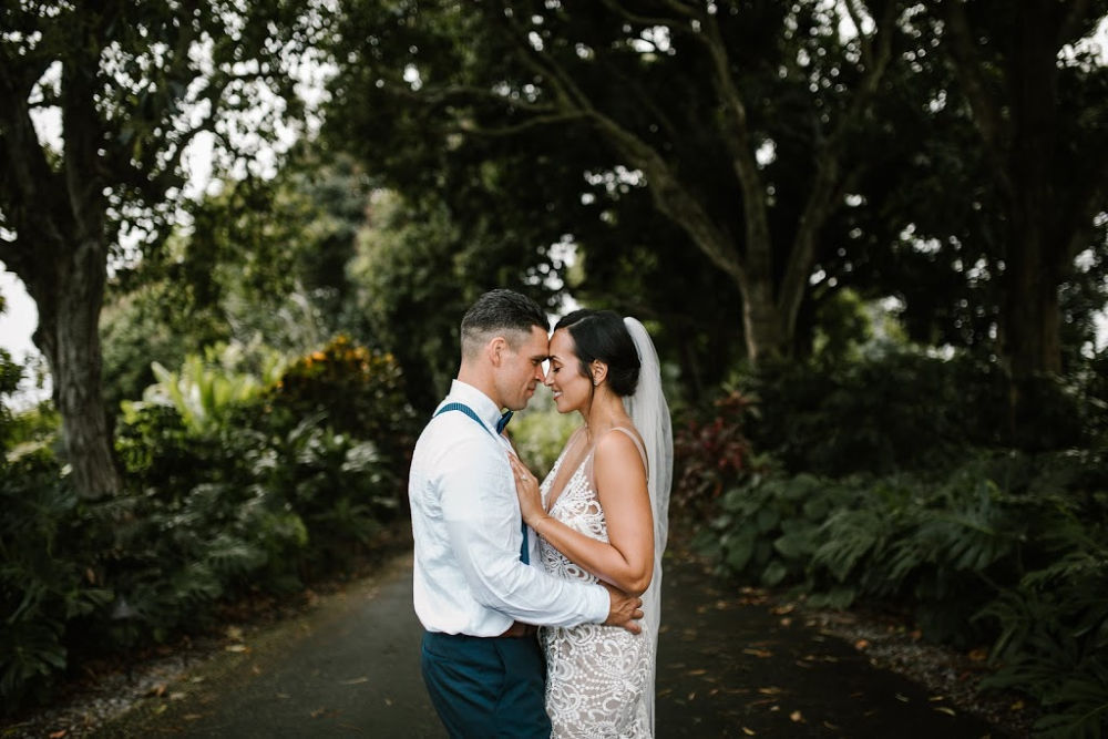 Couple saying their vows at a big island wedding venue