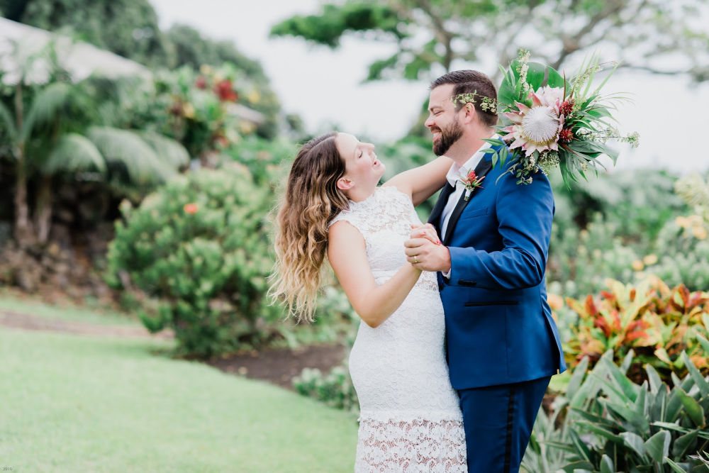 Hawaii elopement at Big Island wedding venue: Couple holding each other laughing