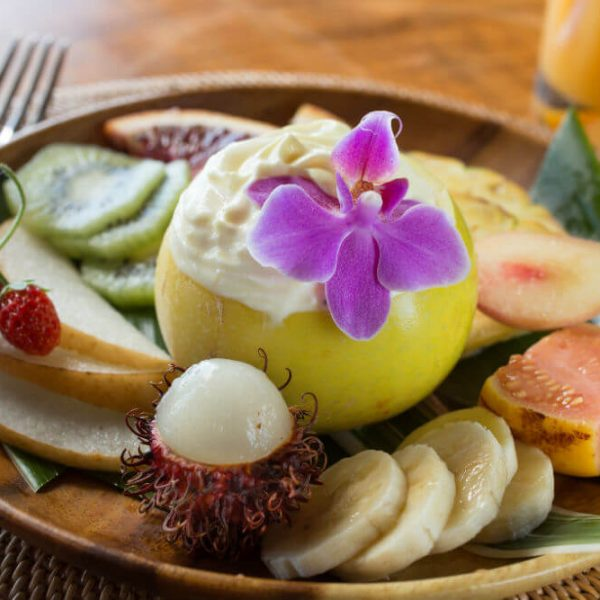 Hawaiian breakfast fruit with bananas, kiwi, and coconut