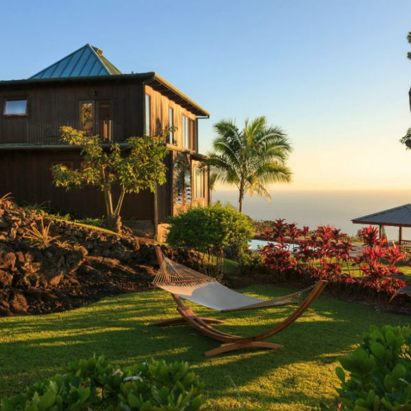 Greenery surrounding the Holualoa Inn with a gazebo and hammock at our Hawaii bed and breakfast
