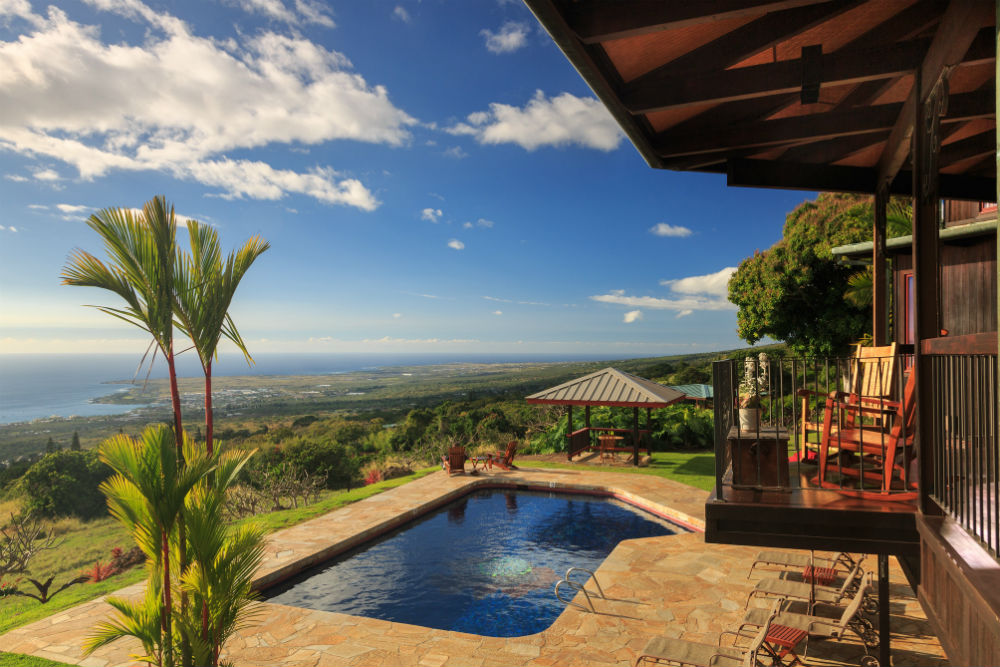 Pool with scenic views of the Kona coast at Big Island Inn