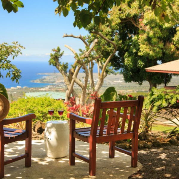 Sitting area with wine and a view of the Pacific Kona coast
