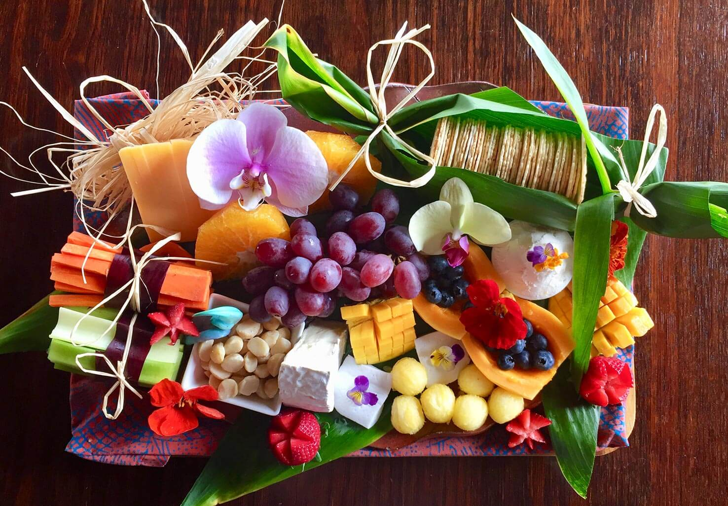 Luxury cheese platter with crackers, fruit, and nuts