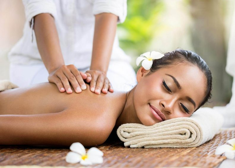 Woman enjoying relaxing massage