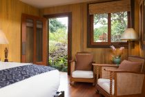 Sitting area by bed and door in the Coffee Cherry Room