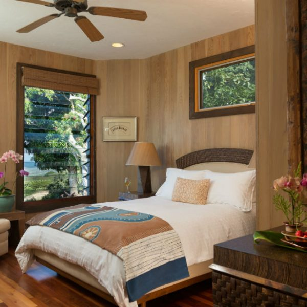 Ocean view Hawaii bedroom by nightstand with flowers in the Orchid Room