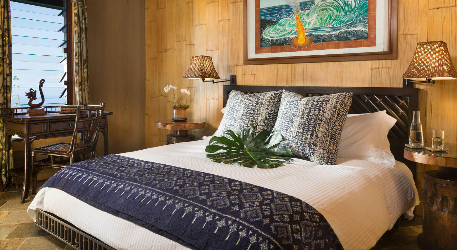 Bed in the Plumeria Suite at our boutique hotel on the Big Island of Hawaii