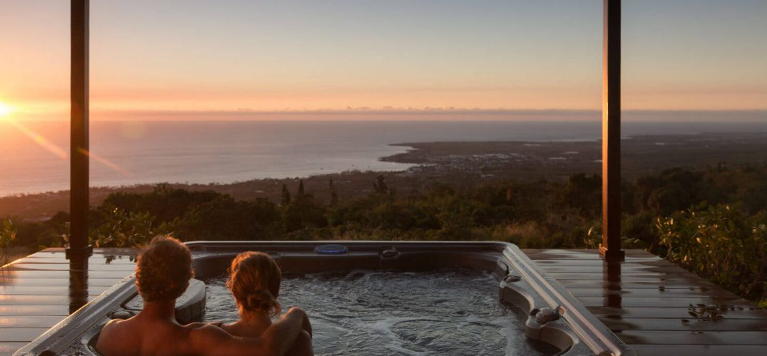 Couple relaxing in hot tub overlook