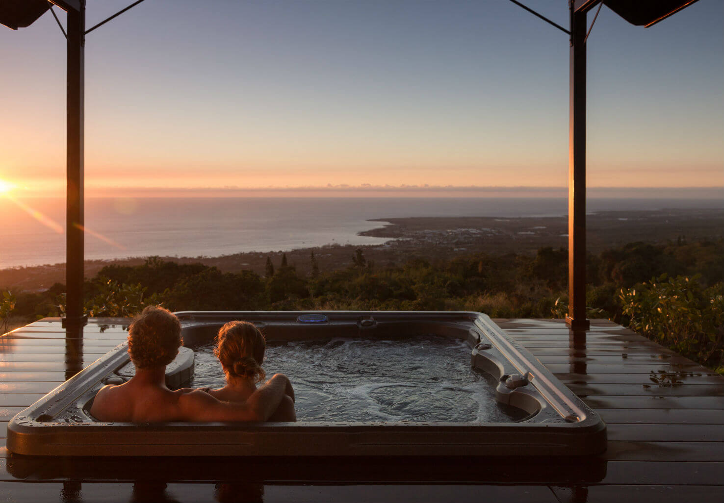 Couple relaxing in hot tub overlook