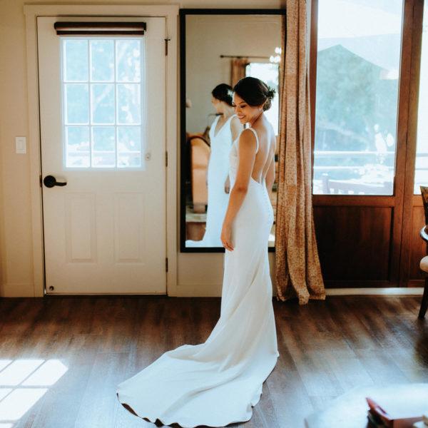 Bride getting ready in Red Barn before Big Island wedding
