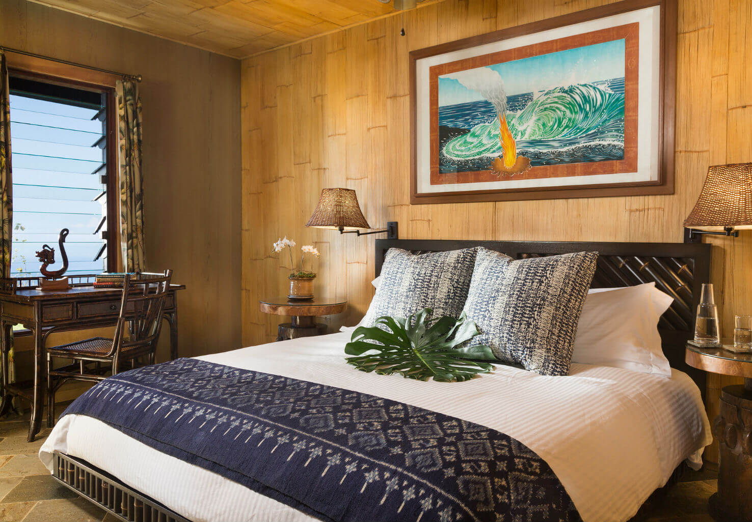 Luxurious bed in the Plumeria Suite at our Big Island bed and breakfast