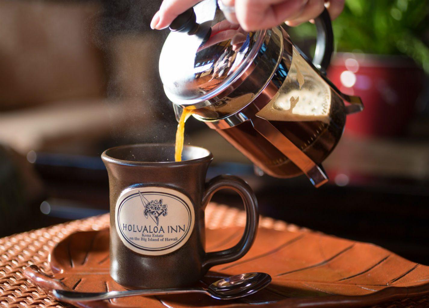 Hot Kona Coffee being poured into mug at the Holualoa Inn