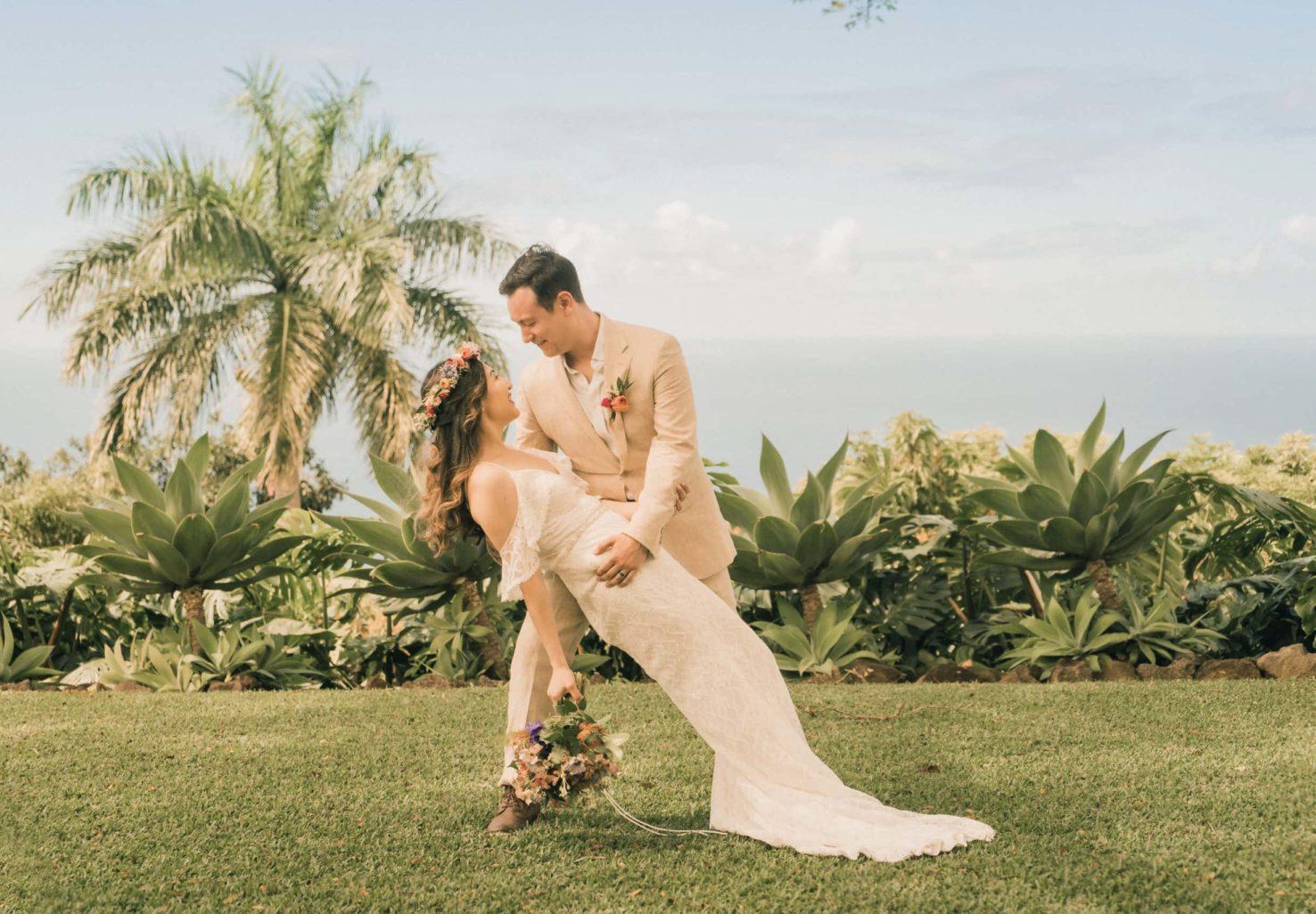 groom dips bride on ocean view Great Lawn during Big Island elopement