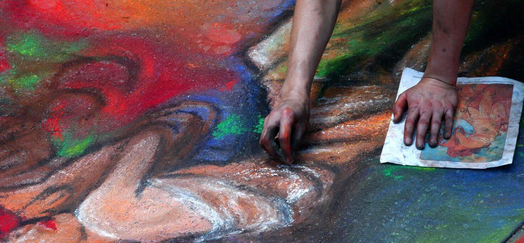 Artist making chalk art