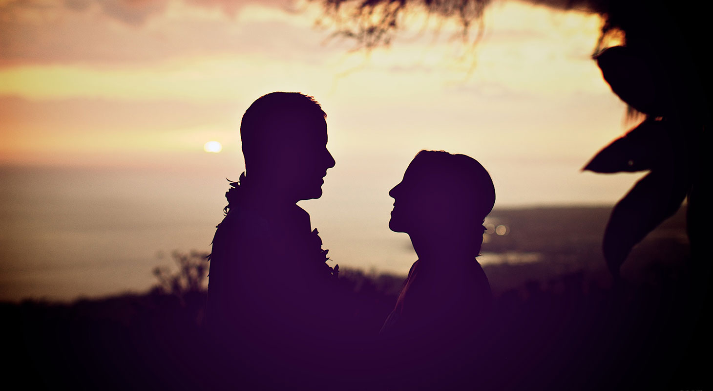 Silhouette of a couple getting married in Hawaii