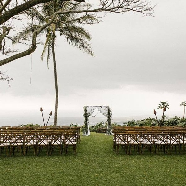 Wedding chairs and arch set out for fall Hawaii wedding