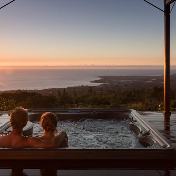 Couple in a Hot tub with ocean view during romantic Hawaiian getaway
