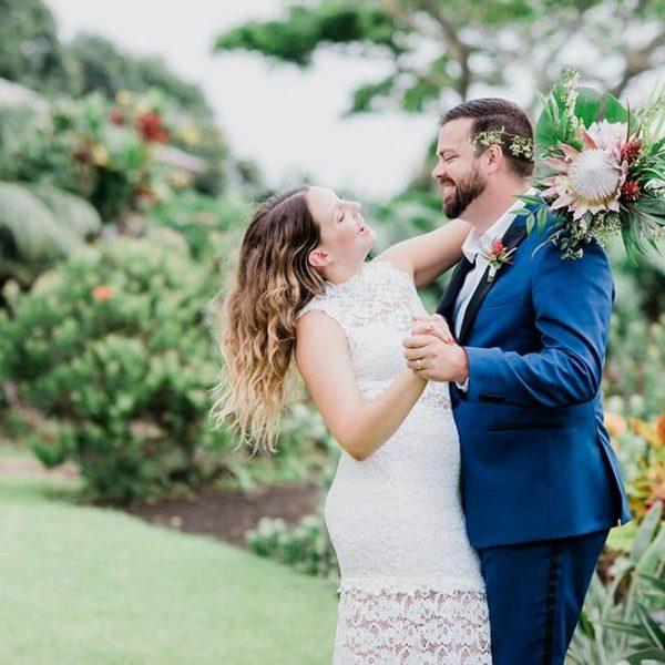 Bride and groom dance together in Hawaiian garden