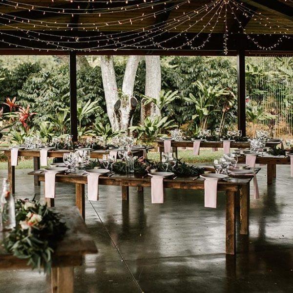 Dining area tables in Hawaiian garden gazebo set for wedding reception