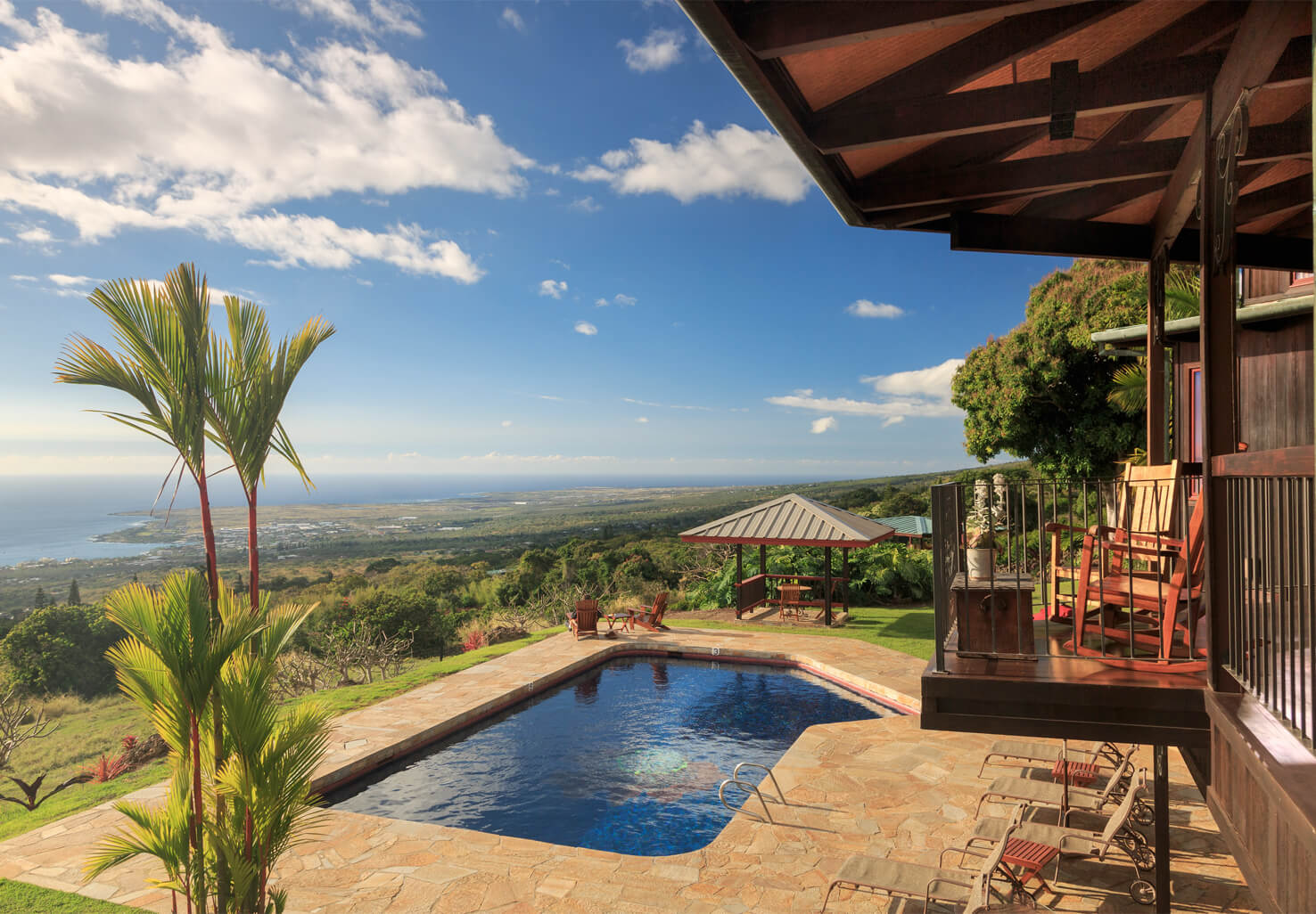 Pool and tropical grouds overlooking the Kona coast at Big Island coffee estate