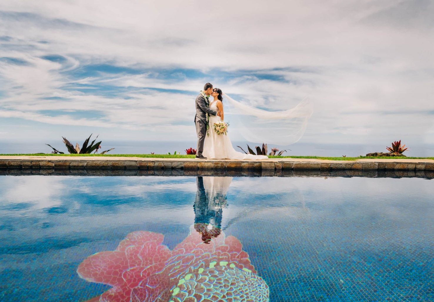 Hawaii Elopement Couple kissing by the poolside at Big Island Elopement