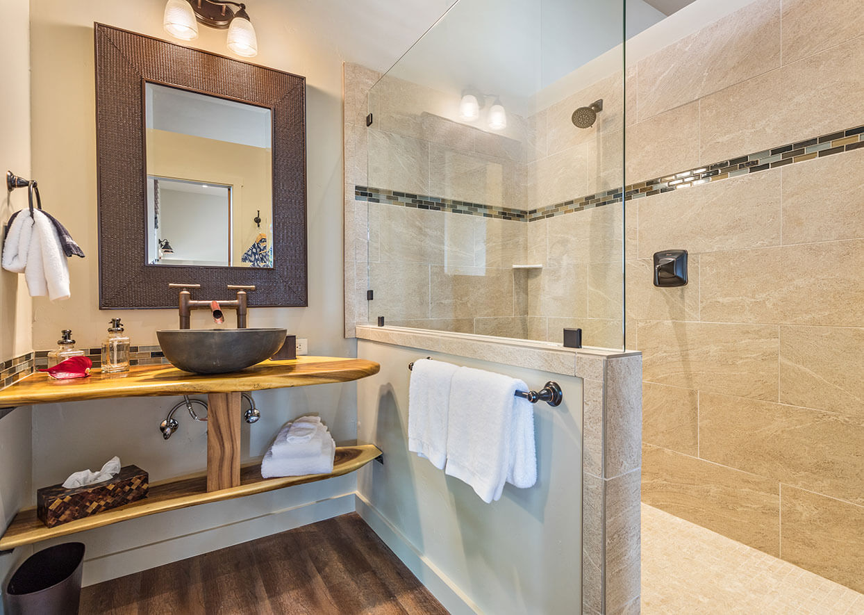 Bathroom with vanity, sink, and shower in the Red Barn