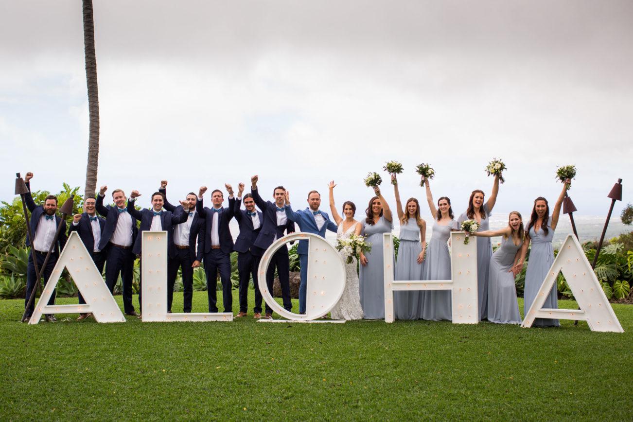 Hawaiian Wedding Party Behind Aloha Sign