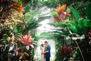Bride and Groom kissing during their Hawaii elopement at Holualoa Inn