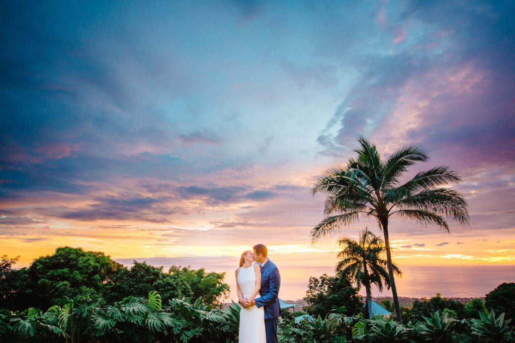 Bride and groom celebrating their Hawaii Elopement at sunset