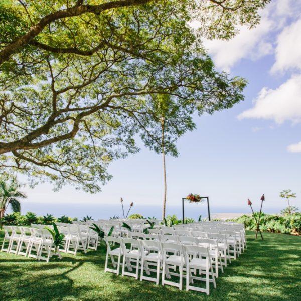Wedding ceremony decor under monkey pod tree at Hawaii wedding ceremony