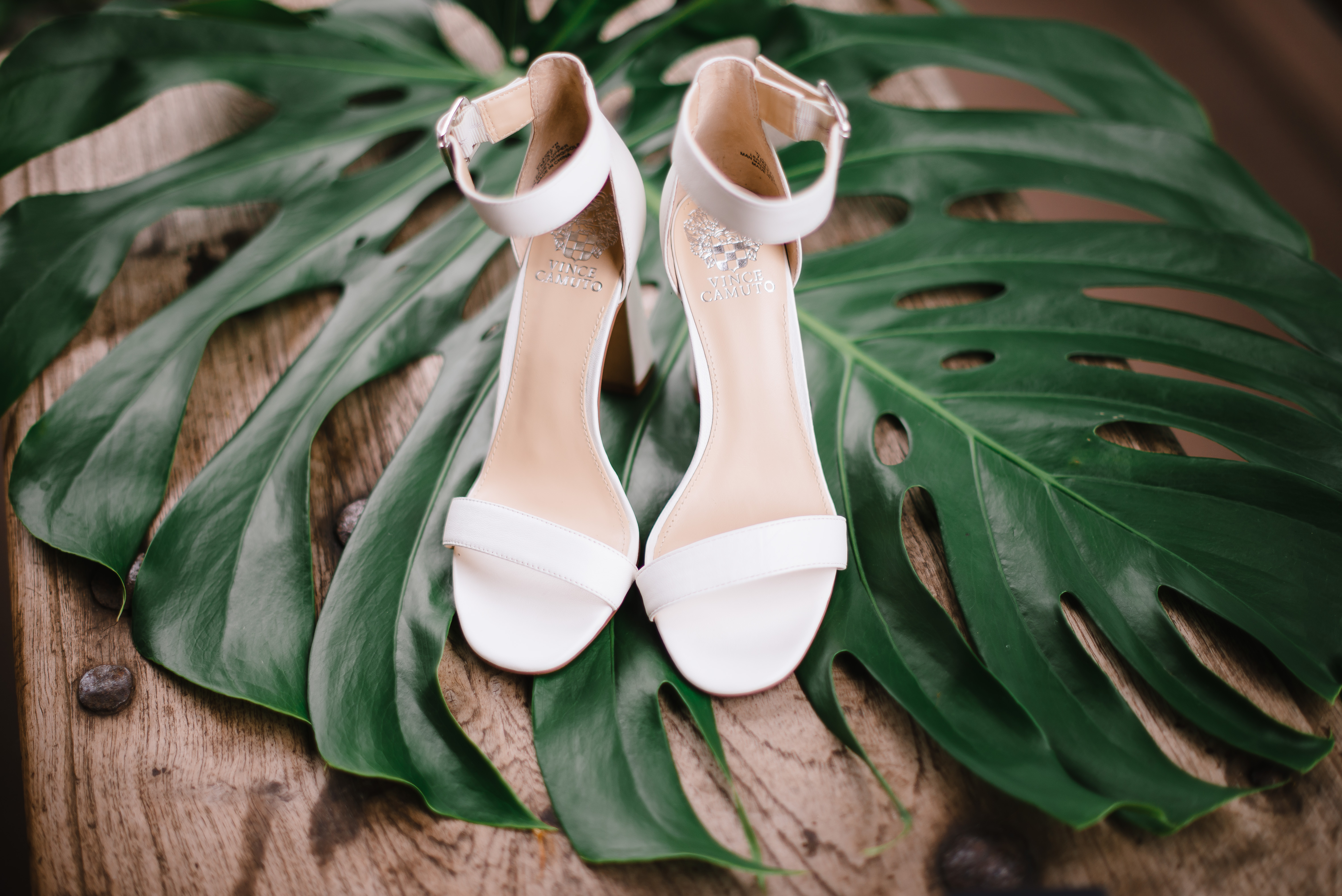 Bride's wedding shoes on Hawaiian palm leaf