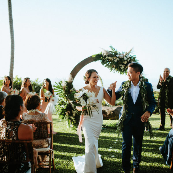 just married couple by circular tropical archway