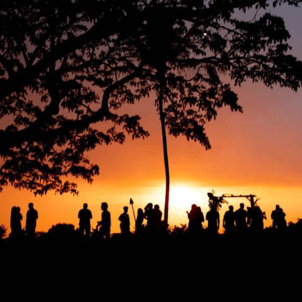 Romantic Kona sunset backdrop to Hawaiian wedding