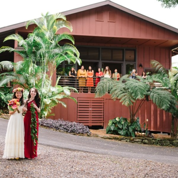 bride and bridesmaid in front of Red Barn