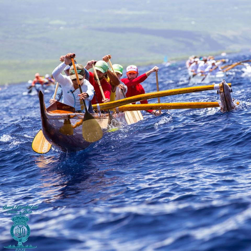 Hawaii Canoe race - Men canoe racing in the ocean