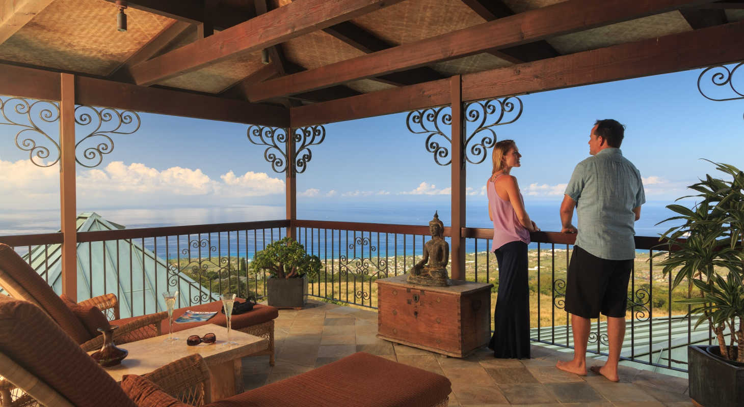 Couple on the lanai looking at the ocean at Hawaii Bed and Breakfast