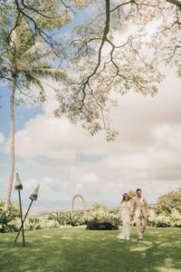 wedding couple on ocean view lawn