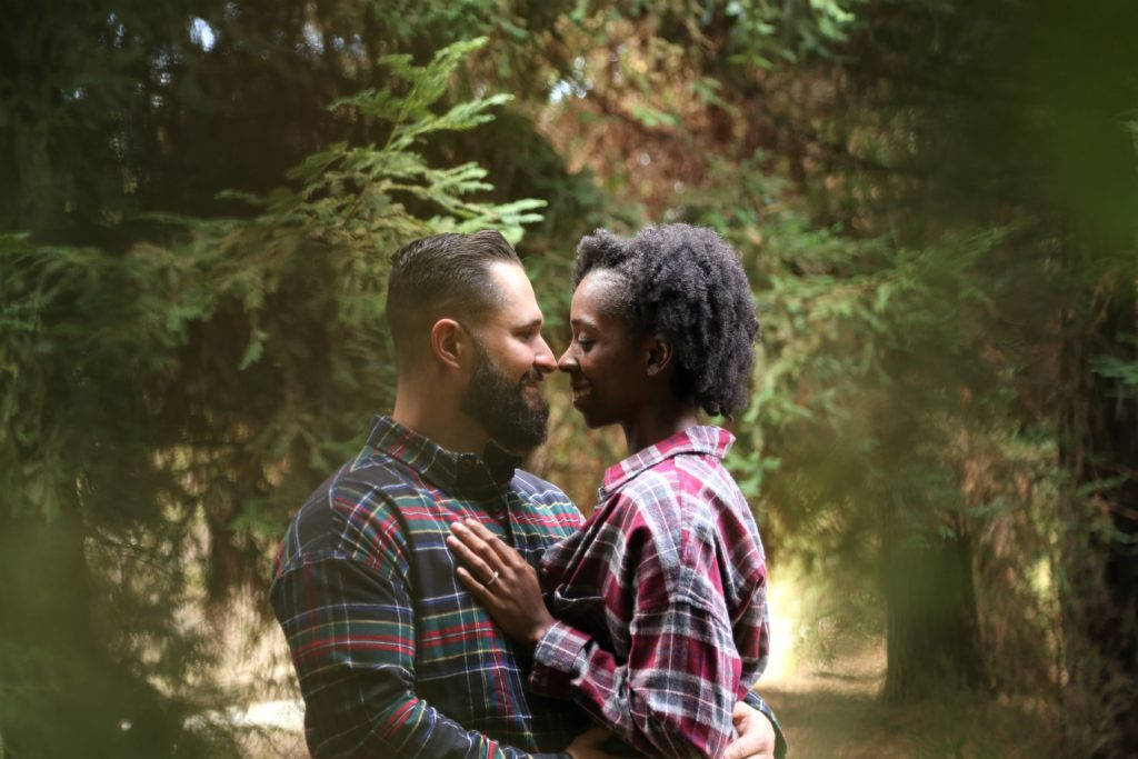 couple embraces on outdoor romantic staycation